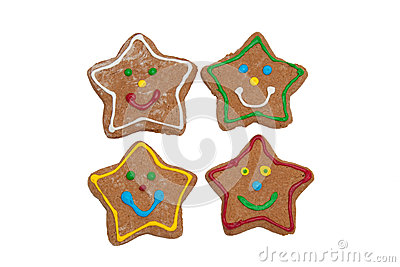 Smiling star shaped Christmas gingerbread cookies