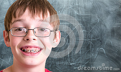 Smiling student In front of chalkboard