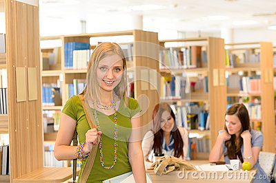 Smiling student girl leaving library high school