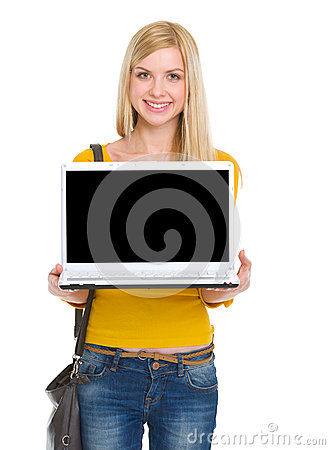 Free Smiling Student Girl Showing Laptop Royalty Free Stock Photography - 29541097