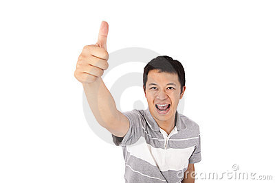 Smiling student gives his thumbs up