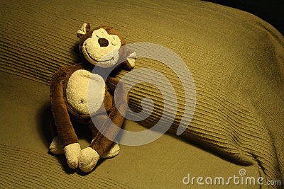 Smiling Stuffed Toy Monkey on Bed