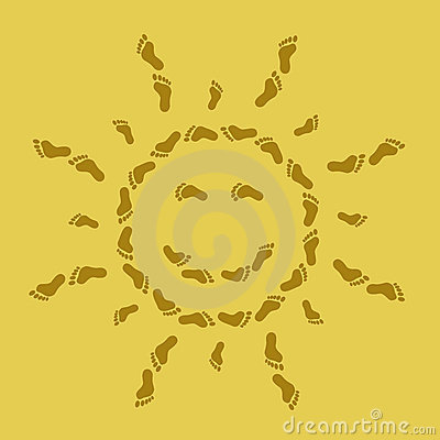 Smiling sun from traces on sand
