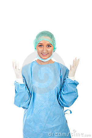 Smiling surgeon showing hands in gloves