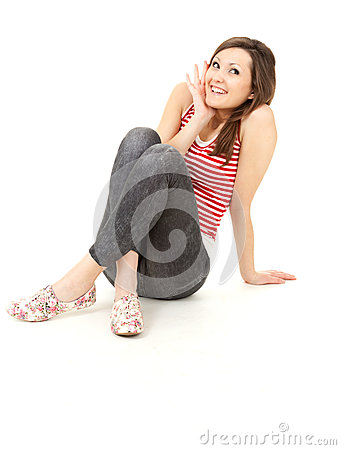 Smiling surprised young woman, full length