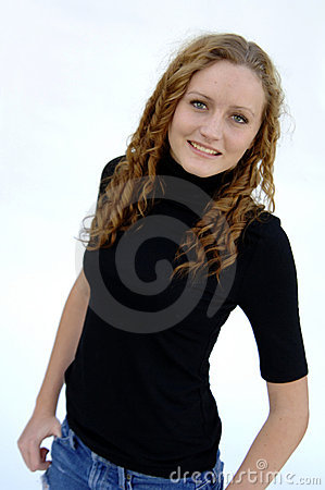 Smiling teen with curly hair