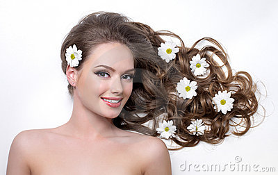 Smiling teen girl with flower in hair