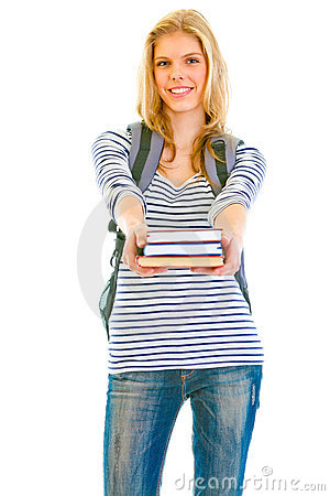 Smiling teen girl with schoolbag giving books