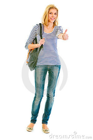 Smiling teen girl with schoolbag showing thumbs up