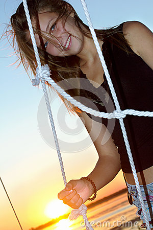 Smiling teen girl at sunset