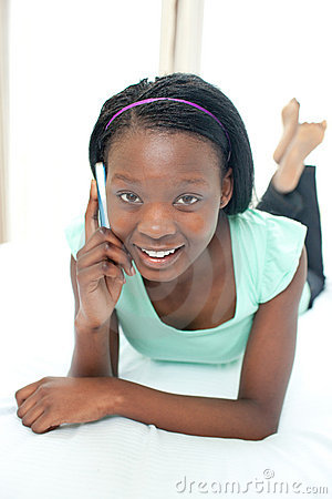 Smiling teen girl using a mobile phone