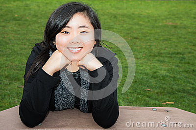 Smiling Teen Resting Chin on Hands