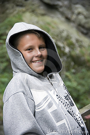 Smiling teenage boy in hood