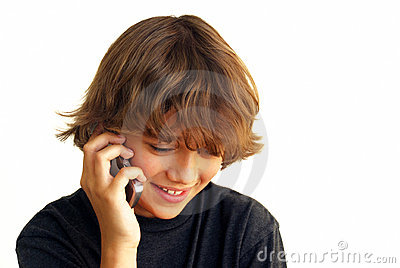 Smiling teenage Boy Talking on Mobile Phone