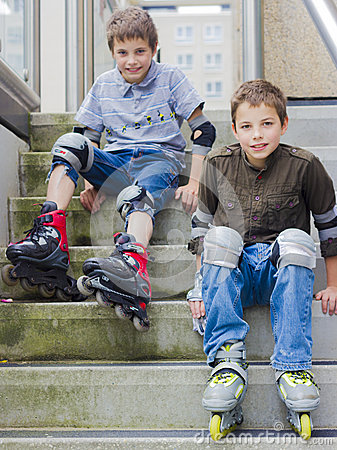 Free Smiling Teenage Boys In Roller-blading Protection Kits Royalty Free Stock Image - 33754266
