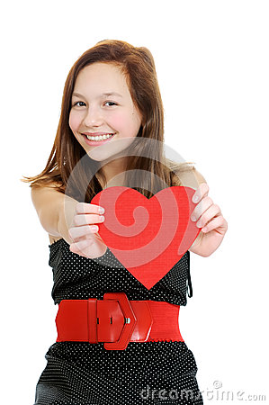 Smiling teenage girl holding valentine heart