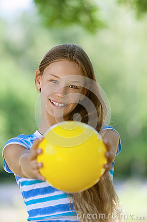 Smiling teenage girl holding yellow