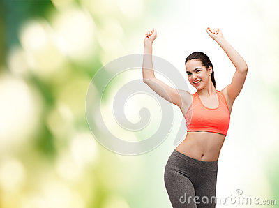 Smiling teenage girl in sportswear dancing