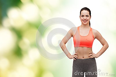 Smiling teenage girl in sportswear