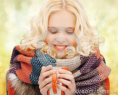 Smiling teenage girl with tea or coffee mug