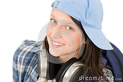 Smiling teenager girl enjoy music with headphones