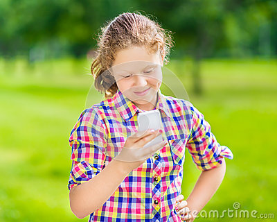 Smiling teenager girl with smartphone