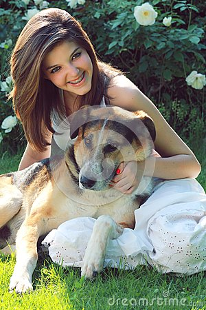 Smiling teenager with her dog