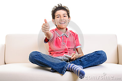 Smiling teenager thumb up smartphone