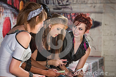 Smiling Teens with Phones