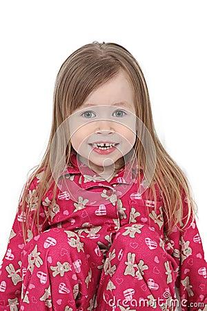Smiling toddler in pajamas