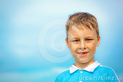 Smiling toothless caucasian child boy
