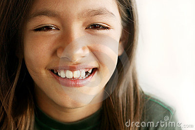 Smiling toothless young girl