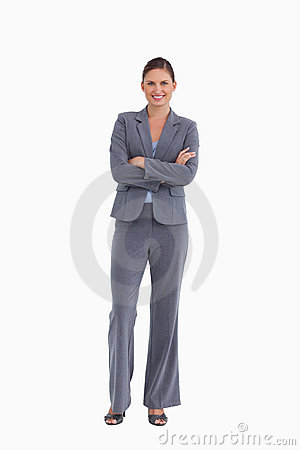 Smiling tradeswoman with her arms folded