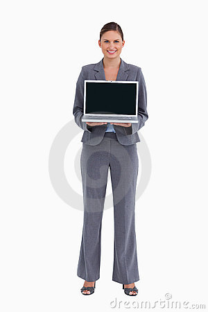 Smiling tradeswoman presenting her laptop screen