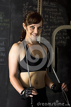 Smiling trainer or athlete in gym