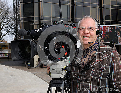 Smiling TV cameraman Editorial Photography