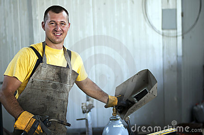 Smiling welder at work
