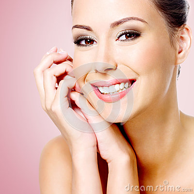 Smiling white woman with healthy skin of face