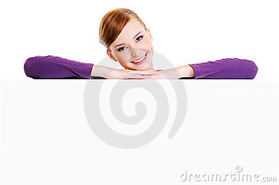 smiling woman above the  blank banner