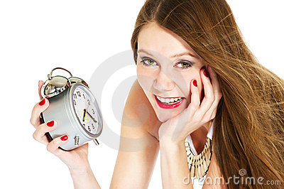 Smiling woman with alarm-clock
