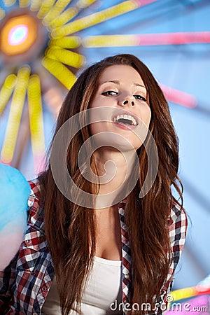 Smiling woman in amusement park.