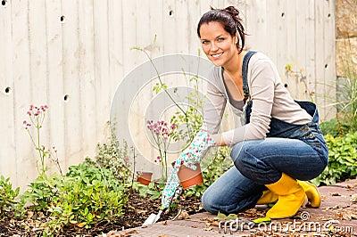 Smiling woman autumn gardening backyard hobby Stock Photo