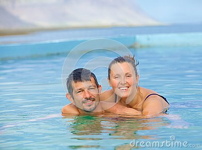 Smiling woman in bathing suit...