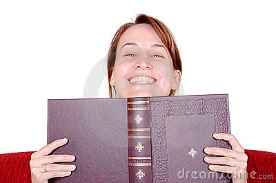 Smiling woman behind book