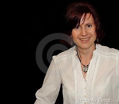 Smiling woman on black