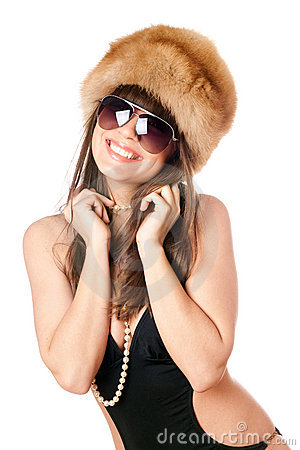 Smiling woman in black swimsuit and fur-cap