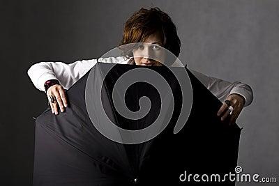 Smiling woman with black umbrella