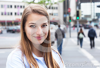 Smiling woman with blond hair in the city Stock Photo