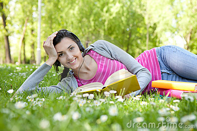 Smiling woman with book in nature