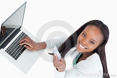 Smiling woman booking flight online
